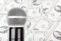 Microphone and money. Professional microphone against money, dollars Stock Photography