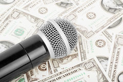 Microphone and money. Professional microphone and money, against money Royalty Free Stock Images