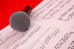 Microphone and music Stock Images