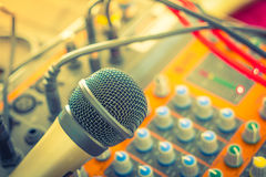 Microphone and Music mixer desk with various knobs ( Filtered im. Age processed vintage effect. ) ( Filtered image processed vintage effect Royalty Free Stock Image