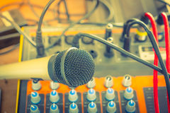 Microphone and Music mixer desk with various knobs ( Filtered im. Age processed vintage effect. ) ( Filtered image processed vintage effect Stock Image