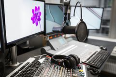 Microphone, Music Mixers And Headphones By Monitors In Radio Stu Stock Photos