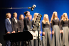 Microphone and music stand. In front of electric pianos on the stage of the theater Royalty Free Stock Images