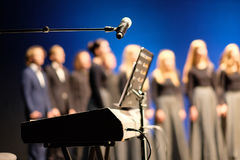 Microphone and music stand. In front of electric pianos on the stage of the theater Stock Photo