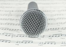 Microphone on Musical notes paper. Music concept Royalty Free Stock Photos