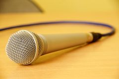 Microphone. On my yellow desk Royalty Free Stock Images