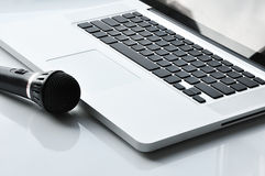 Microphone near laptop Stock Image