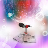 Microphone with newspaper Stock Image