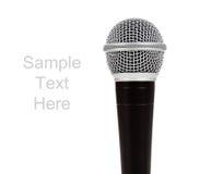 Microphone noir et argenté sur le blanc avec le texte Image libre de droits