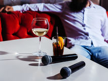 Microphone and nonalcoholic cocktail Stock Photo