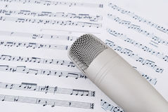 Microphone and notes. Professional microphone and musical notes royalty free stock photos