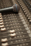 Microphone on old dirty sound mixer pult. Stock Photos