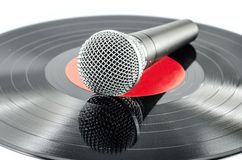 Microphone on old disc Stock Image