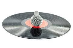 Microphone on old disc Royalty Free Stock Photos