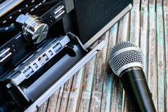 Microphone and old tape recorder. Microphone old radio with one cassette player Stock Image