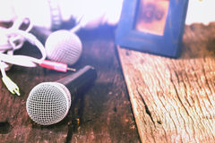 The microphone on the old wooden floor Royalty Free Stock Photo