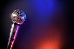 Free Microphone On Black Table With Red And Blue Lights Top Stock Images - 81225134