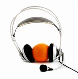 Microphone and orange. Headsets and orange on a white background Royalty Free Stock Photos
