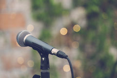 Microphone at outdoor concert. Againt bokeh background with vintage stock photos