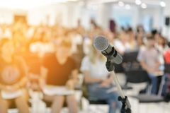 Microphone in seminar room. Microphone over abstract blurred of attendee in seminar room Stock Photography