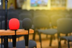 Microphone over the blurred business conference hall or seminar. Room, Blurred background stock image