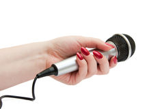 Microphone over white. Dynamic silver microphone in woman hand isolated over white background stock photos