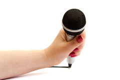 Microphone over white. Silver microphone in female hand isolated over white background royalty free stock photo