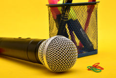 Microphone with paper holding pins and stationery box - Motivational Speaker Royalty Free Stock Images