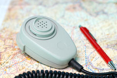 Microphone and pen on aeronautical chart. ATC microphone and red ballpoint pen on aeronautical chart Royalty Free Stock Photos
