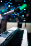 Microphone and piano. In nightclub Stock Images