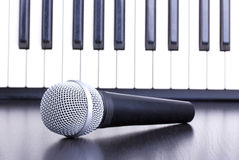 Microphone and piano keyboard Royalty Free Stock Photos