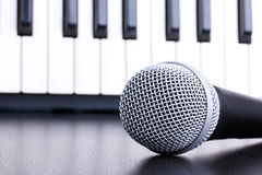 Microphone on piano keyboard background Royalty Free Stock Photo