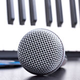Microphone and piano keyboard Stock Photos