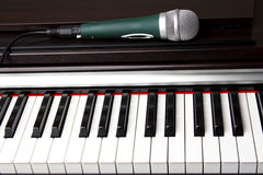 Microphone on the piano keyboard Royalty Free Stock Photos