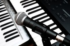 Microphone and piano keyboards Stock Photography