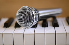 Microphone and Piano. Microphone sitting on piano keyboard Royalty Free Stock Image