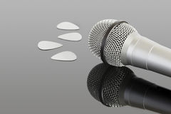 Microphone and plectrums. Microphone and audio jack cable. Can be used in a music concept Royalty Free Stock Images