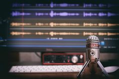 Microphone with a podcast icon. On a table Royalty Free Stock Images