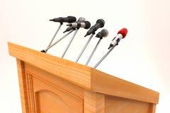 Microphone on Podium. Illustration of microphones on podium for adressing public Stock Photo