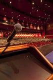 Microphone on Podium. In large theater auditorium stock image