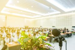 Microphone on podium in the auditorium. With participants royalty free stock photos