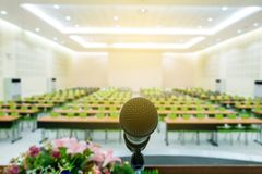 Microphone on podium in the auditorium. Without participants royalty free stock image