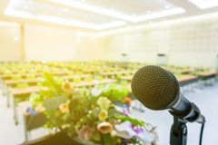 Microphone on podium in the auditorium. Without participants stock image