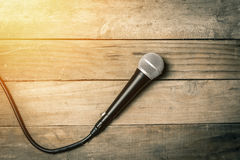Microphone on podium. Microphone with cable on old vintage wooden background royalty free stock images