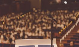 Microphone on the podium in conference hall. Microphone on the podium in seminar or conference hall royalty free stock photo