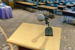 Microphone on podium Stock Images