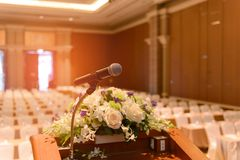 Microphone on podium in empty room. Microphone on podium in empty conference room stock images