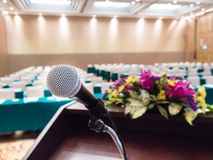 Microphone on podium. In empty conferences room Royalty Free Stock Photo