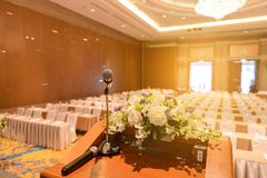 Microphone on podium in empty room. Microphone on podium in empty conference room royalty free stock photo