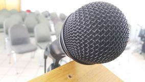 Microphone on podium in room Royalty Free Stock Image